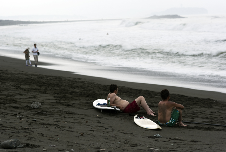 surfers on the beach in Tsujido